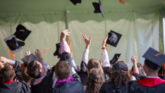 Graduates tossing their hats into the air